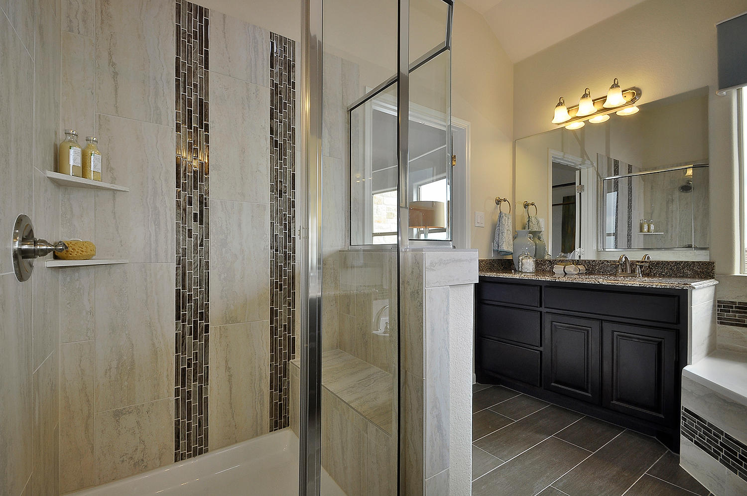 Burrows Cabinets master bath vanity in Espresso with glass shower