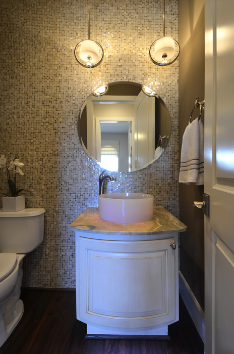powder room with curved cabinet door