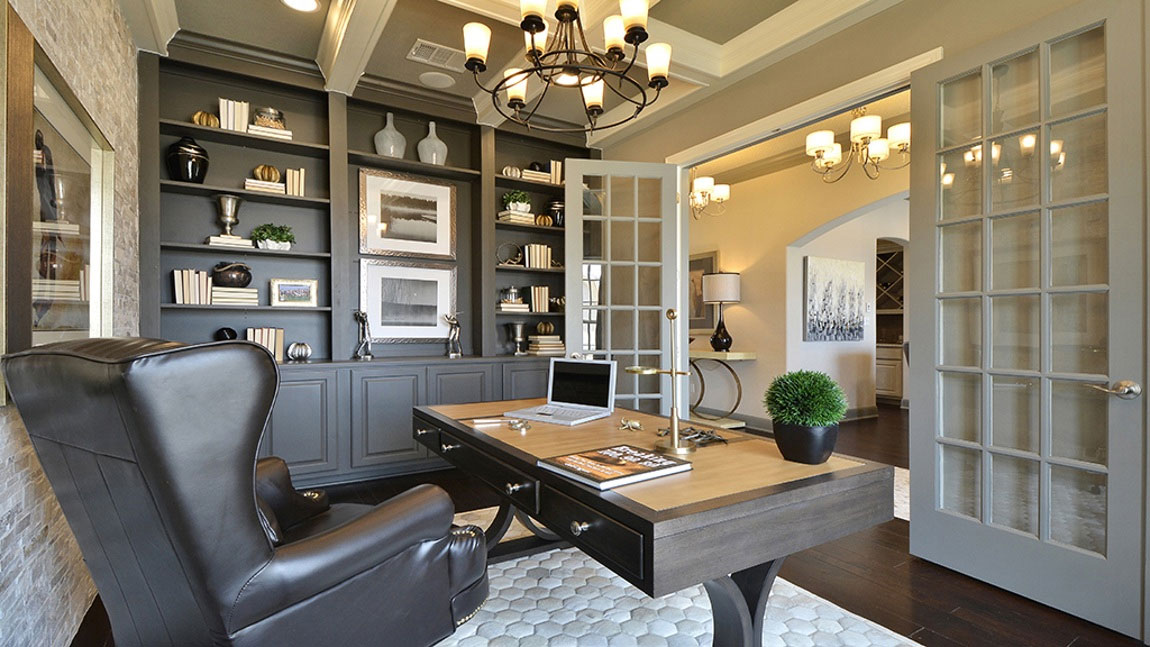 Burrows Cabinets' study with built in bookshelves and cabinets in Umber gray