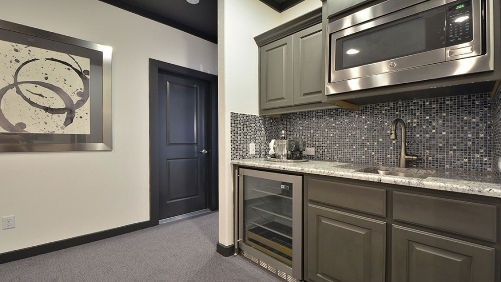 Burrows Cabinets wet bar cabinets in Umber gray with wine refrigerator and microwave