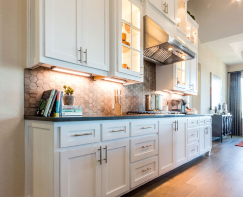 Burrows Cabinets' kitchen with Shaker doors in Bone white and Dallas feet