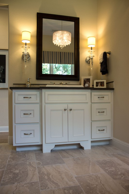 Burrows Cabinets' bathroom vanity with Kensington doors and Scrolled Feet