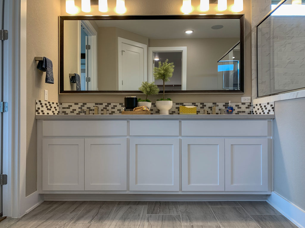 Master bath in Frost by Burrows Cabinets with Shaker doors