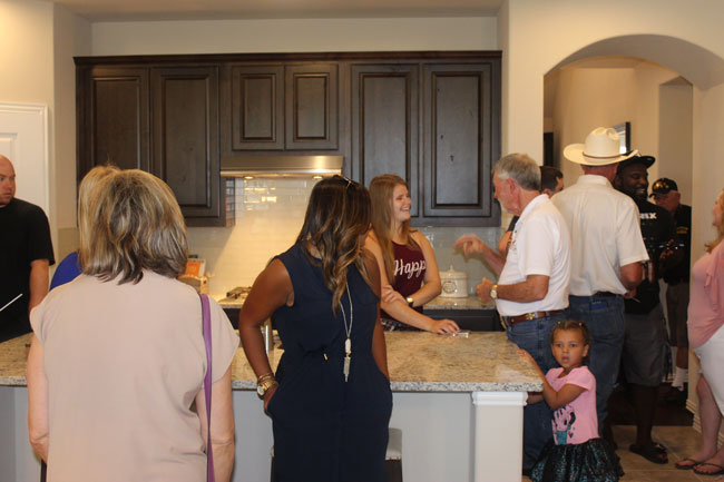 BC Operation Finally Home - family in kitchen