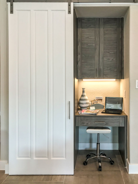 Barn door with hidden, built-in desk and cabinet in EVRGRN Rok