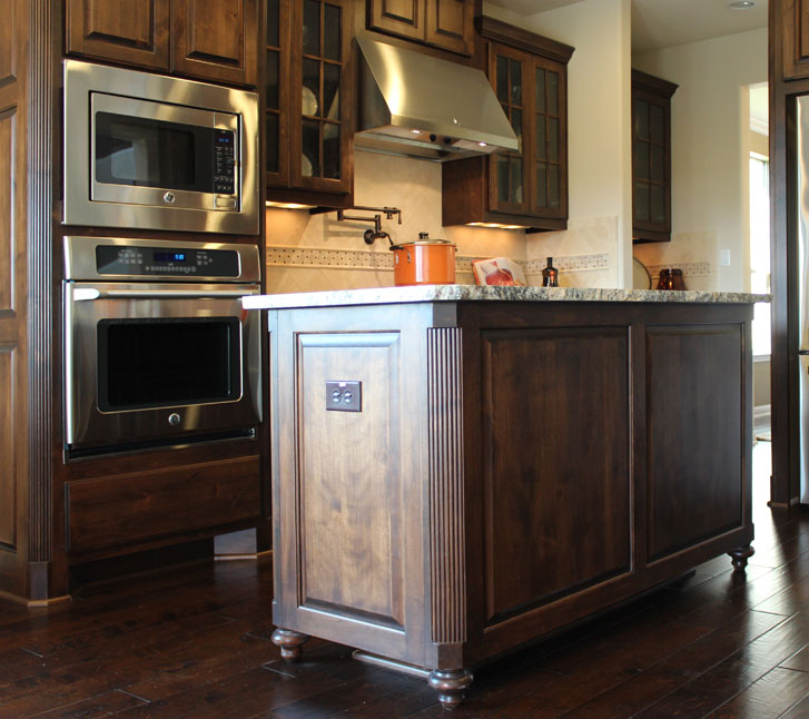 Burrows Cabinets kitchen island in Verona with Bunn feet and integrated corners in style 100