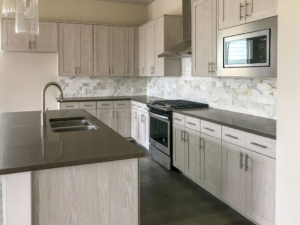 Kitchen EVRGRN Artisk 5pc with gray and white backsplash