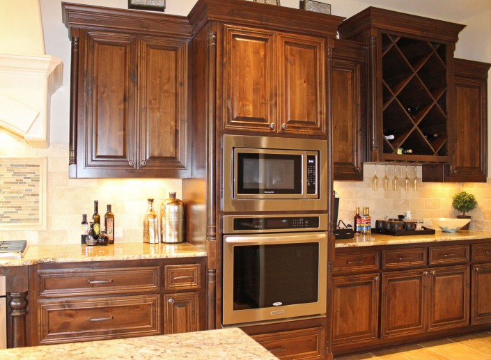 Burrows Cabinets' knotty alder cabinets with big x wine rack