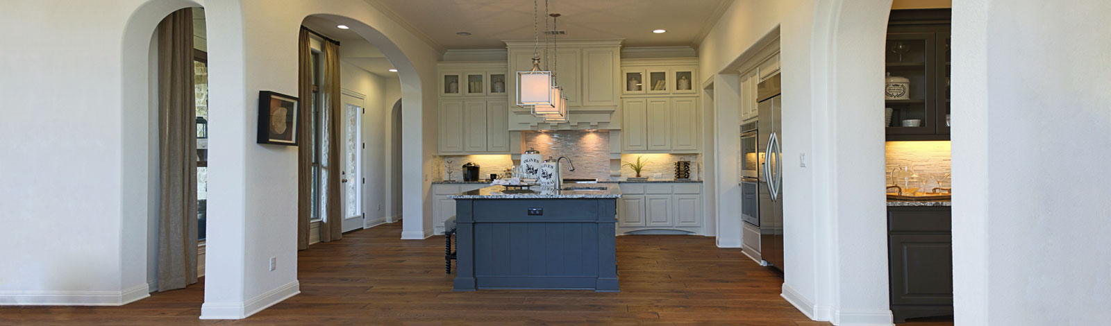 Burrows Cabinets' kitchen in bone with umber island