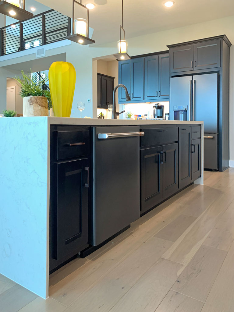 Kitchen island cabinets by Burrows Cabinets in Beech Espresso with Briscoe doors