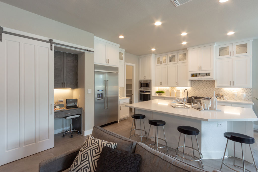 Kitchen with Frost white cabinets and hidden desk in EVRGRN Rok