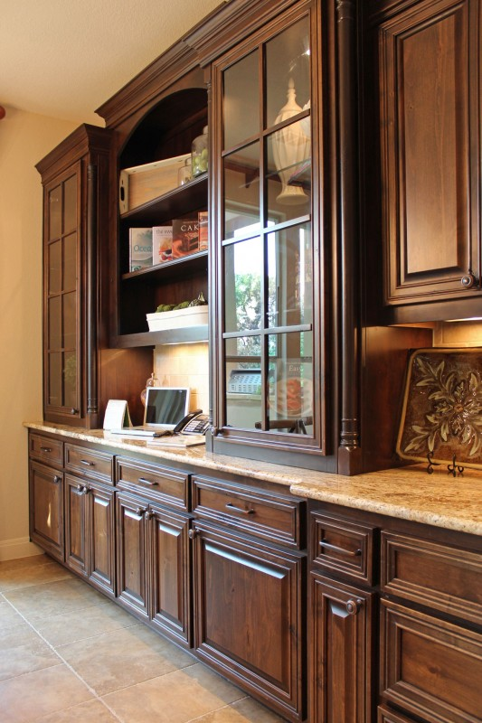 Burrows Cabinets' kitchen hutch with glass doors and mullions in stained knotty alder