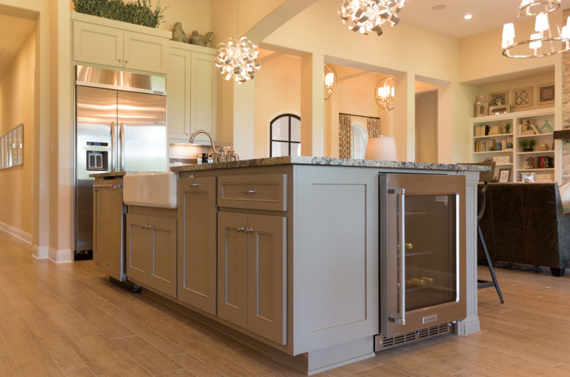 Burrows Cabinets' gray kitchen island with built in wine refrigerator