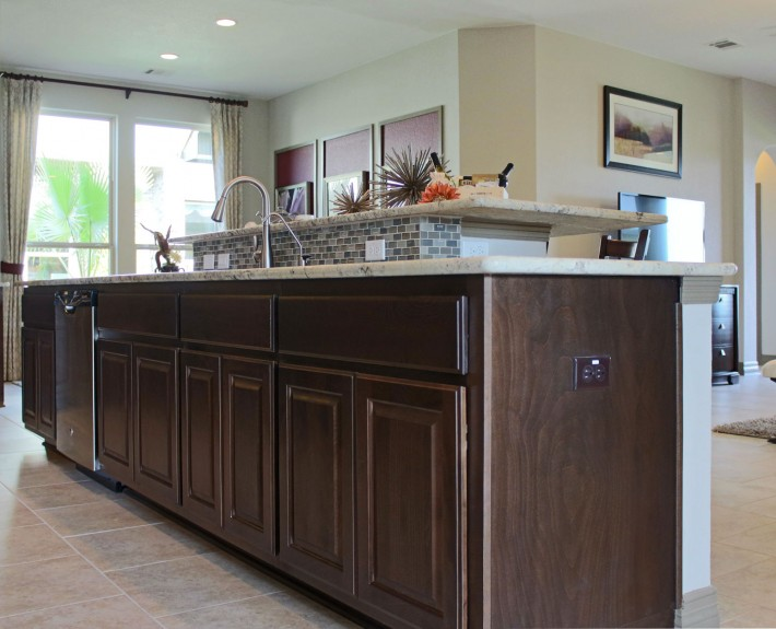 Burrows Cabinets kitchen island in Kona with raised eat in breakfast bar