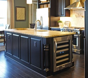 Burrows Cabinets kitchen island with Monaco Posts and wine refrigerator (C) 2014 Burrows Cabinets