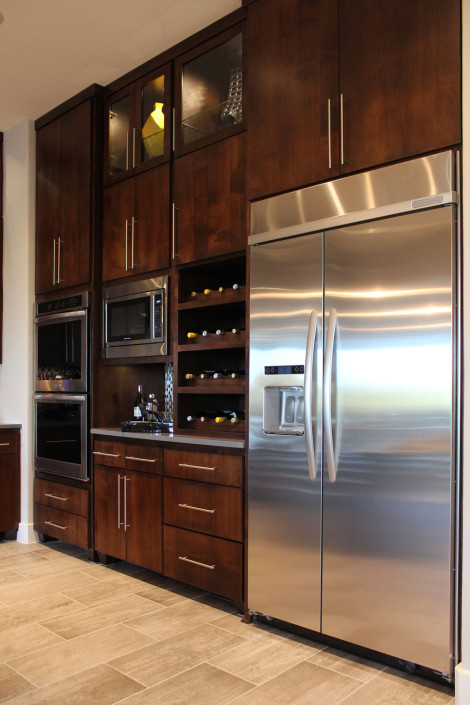 Burrows Cabinets kitchen with modern SoCo cabinet doors in knotty alder and scalloped wine rack