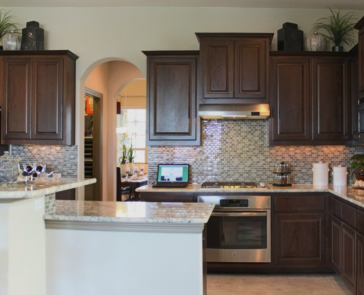 Burrows Cabinets kitchen cabinets in Kona with raised island bar