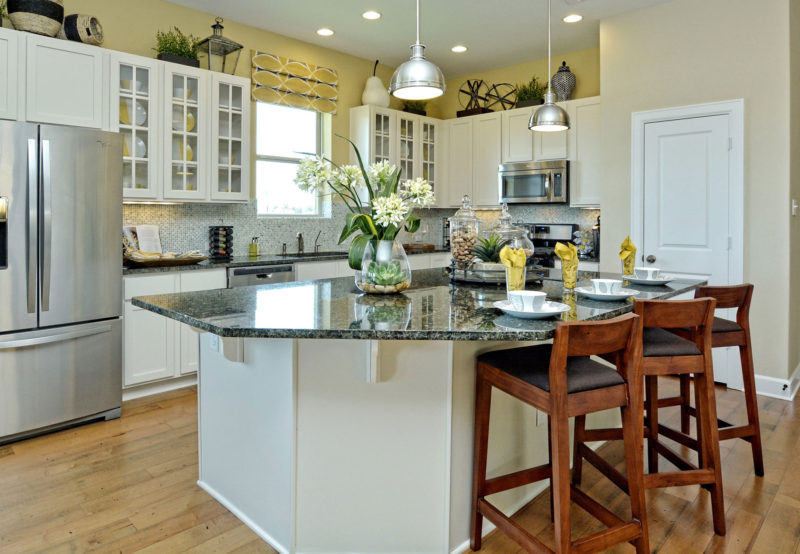 White and yellow kitchen with shaker style doors and mullion doors with glass by Burrows Cabinets