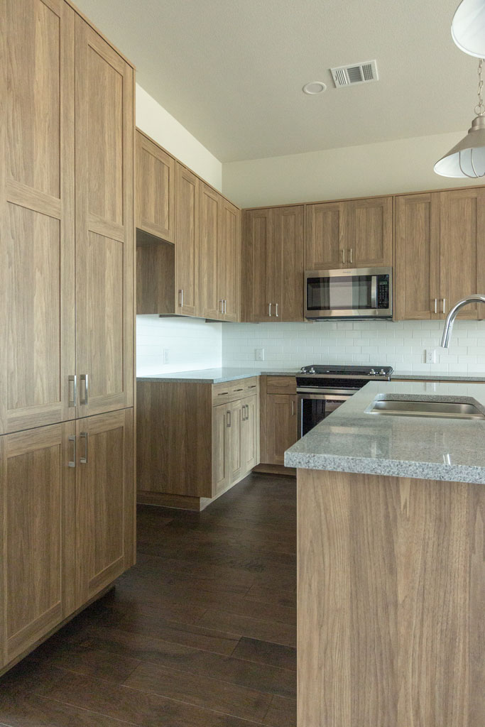 EVRGRN kitchen in Straan with 5-piece doors and tall pantry cabinet