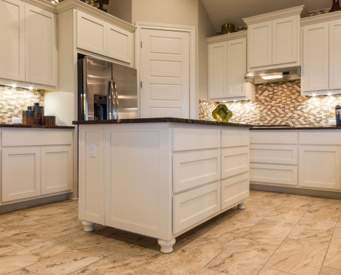 Burrows Cabinets' white kitchen with Shaker doors and Bunn feet on island
