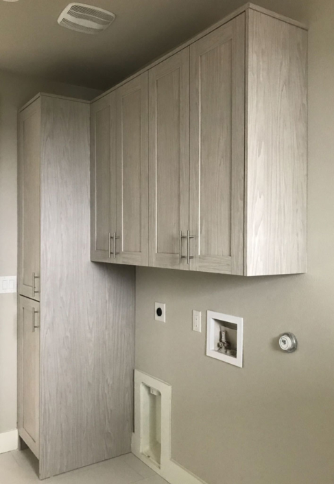 Laundry room cabinets in EVRGRN Artisk