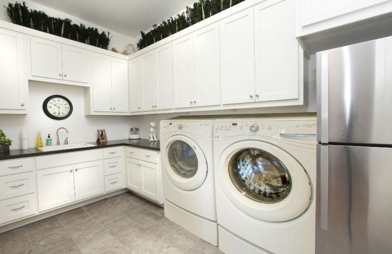 Burrows Cabinets' laundry room with shaker doors in bone white