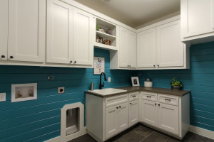 Burrows Cabinets' white laundry room cabinets - Terrazzo