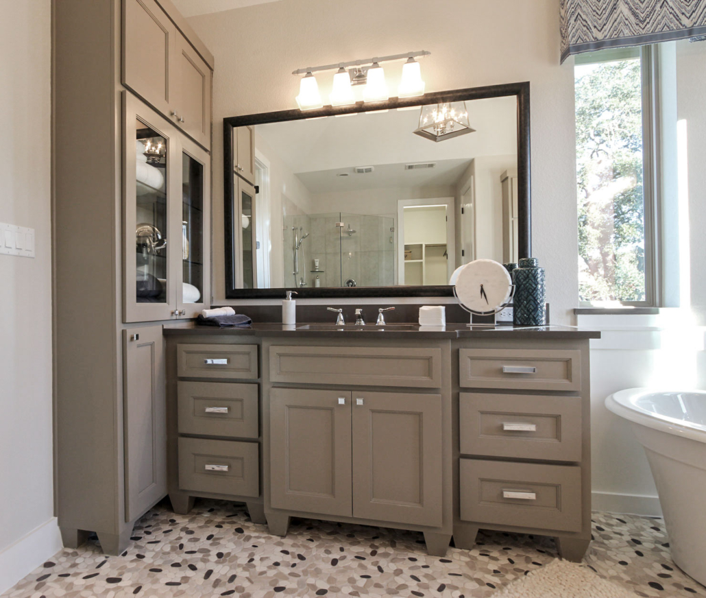 Bath cabinets bumped out with tall linen cabinet