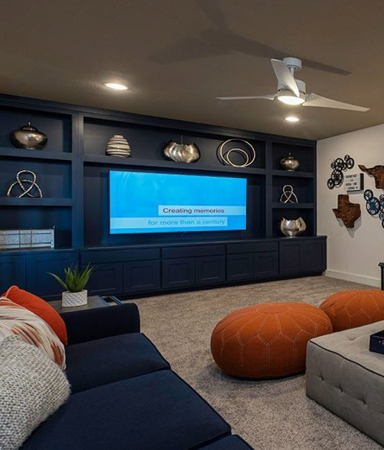 Burrows Cabinets' built-in media cabinets in Naval blue with Briscoe doors