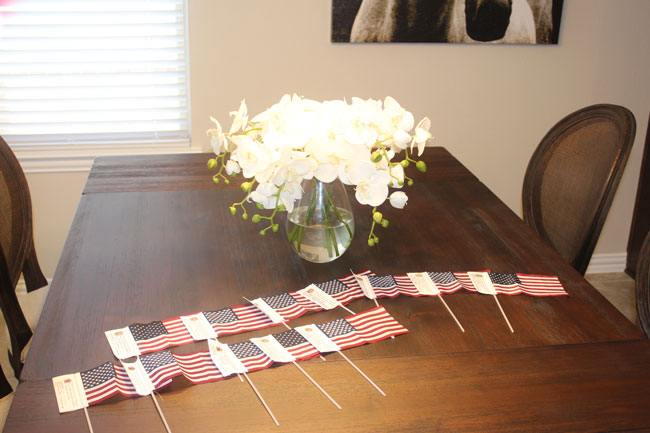 BC Operation Finally Home - table with flags
