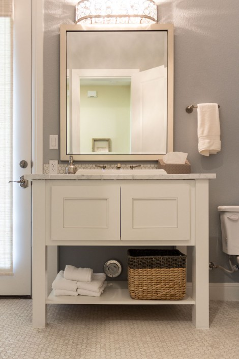 Burrows Cabinets' bathroom vanity with Kensington doors and open storage