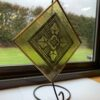 Yellow Stained Glass Pane on Stand