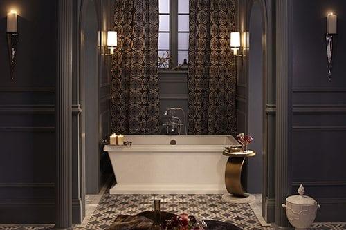 Blue bathroom with white bathtub