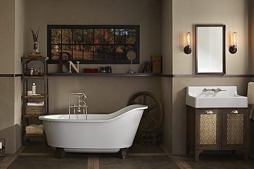 White bathtub and white sink in a fancy bathroom