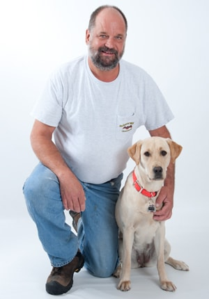 company owner and his dog