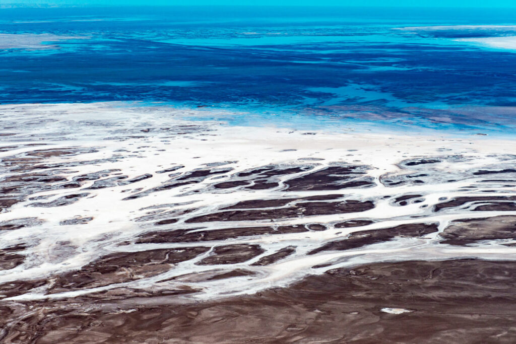 The Colorado River once flowed into the Gulf of California, but now its dried-up delta is a desiccated landscape of old river channels, salt tidal flats, and mineral deposits. PHOTO BY TED WOOD