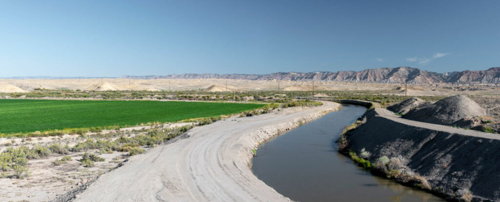 A system of canals, pipes, and ditches irrigate 23,000 acres of farmland in the Grand Valley with water from the Colorado River.