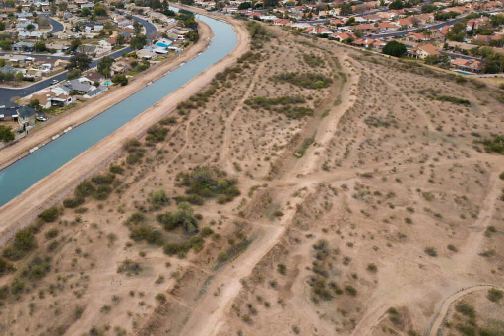 The remnants of canals used by the Hohokam people for centuries can still be seen in the sandy soil here in Mesa, Arizona, with the ancient canal path running parallel to the modern-day South Canal, which carries water from the Salt River. PHOTO BY TED WOOD