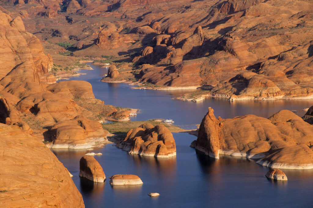Lake Powell in Utah stores water from the Upper Colorado Basin for delivery to Lake Mead, the key reservoir on the Colorado. In the last water year, storage in Lake Powell has fallen by 1.54 million acre-feet, and the lake is only 39 percent full. PHOTO BY TED WOOD