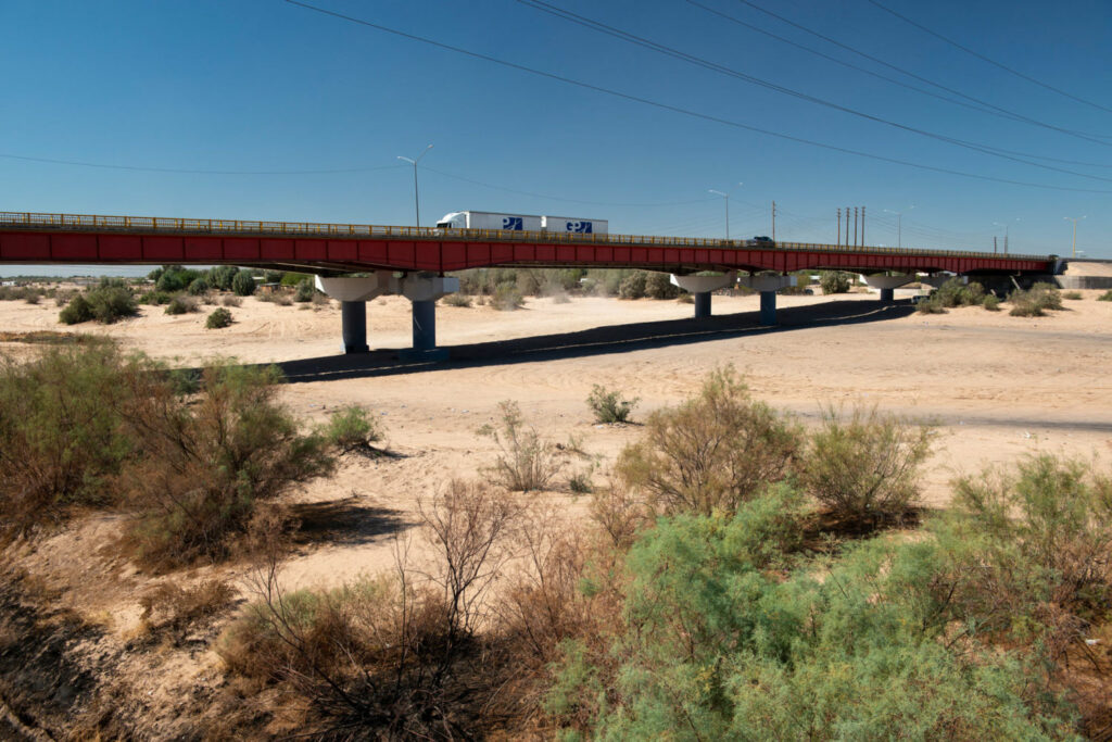 A highway passes over the dry, historic riverbed of the Colorado River near the town of San Luis Rio Colorado in Baja California, Mexico. PHOTO BY TED WOOD