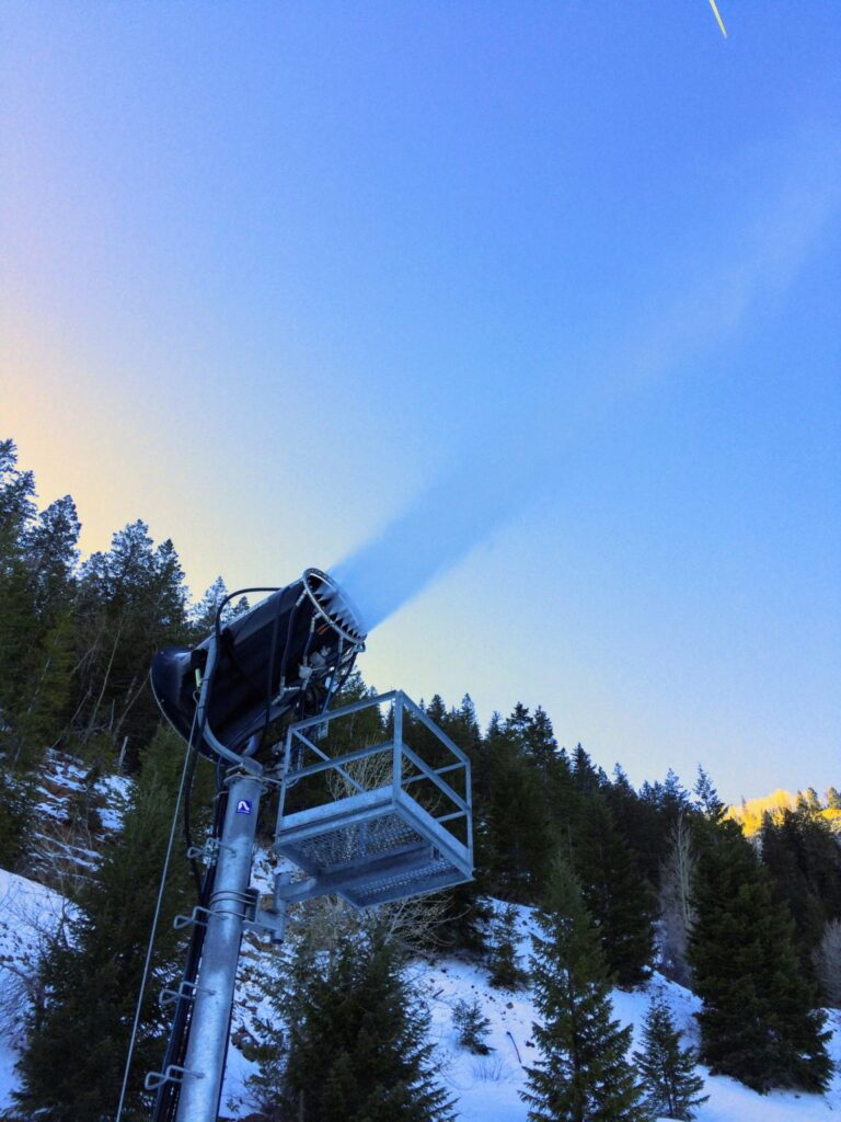 A machine blows artificial snow at the top of Little Nell on Aspen Mountain in Dec. 2017. SkiCo is building out snowmaking infrastructure as one way to adapt to a changing climate, but that, too, relies on sufficient water in local streams and cold enough temperatures. Photo by Elizabeth Stewart-Severy / Aspen Journalism