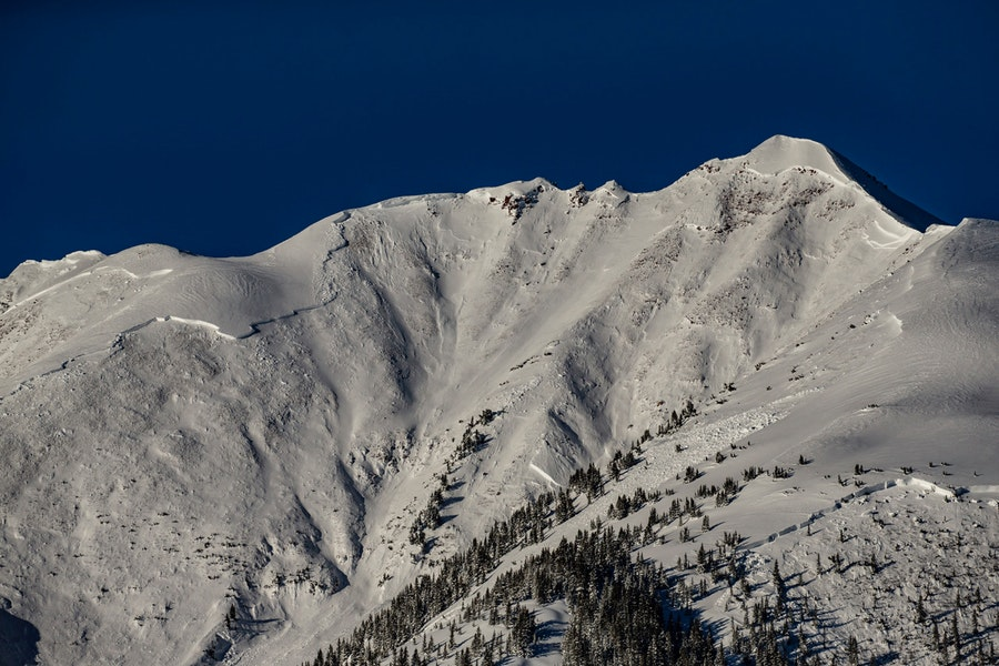 A large natural avalanche released on Garrett Peak, which can be seen from Snowmass Ski Area, on March 13, 2019. Scouring the entire mountain along with some adjacent slopes, the slide was one of the three most destructive in Colorado's history, all occurring last March. Photo by Colorado Avalanche Information Center.