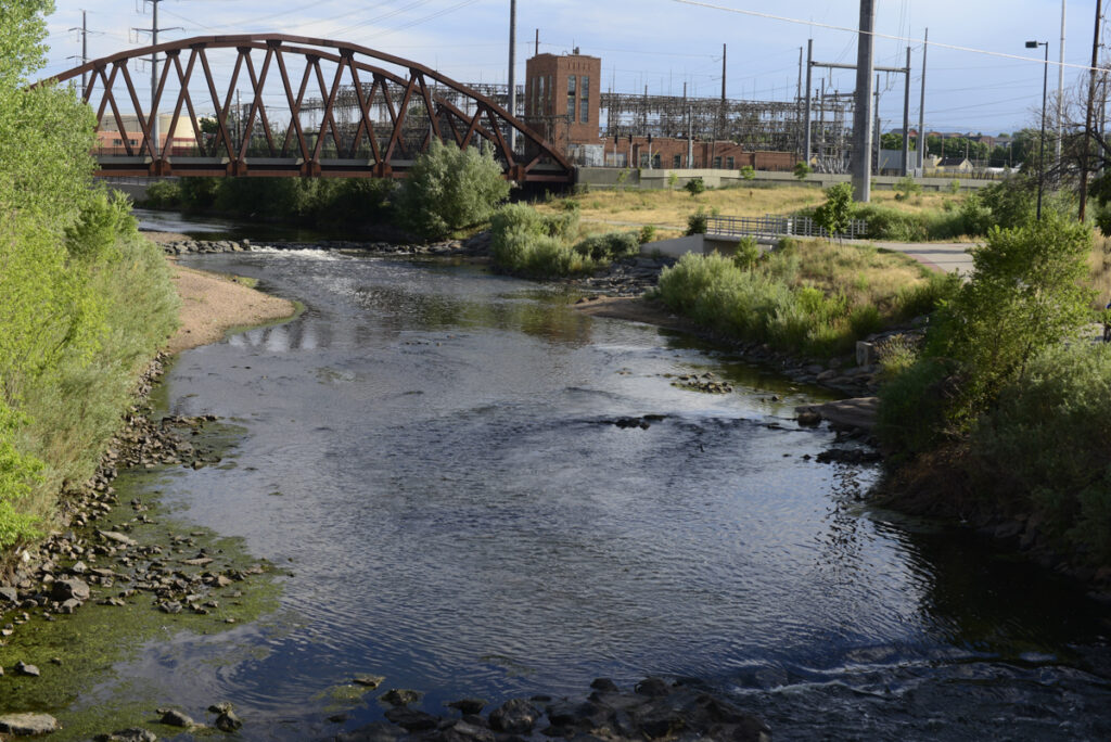 The South Platte River runs by an electricity plant near I-25 in Denver.