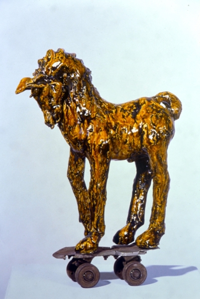 """Dear Leo I Stole This Too, amber glazed earthenware on found object (Ohr O'Keefe Museum of Art collection). 19x14x5"""""""