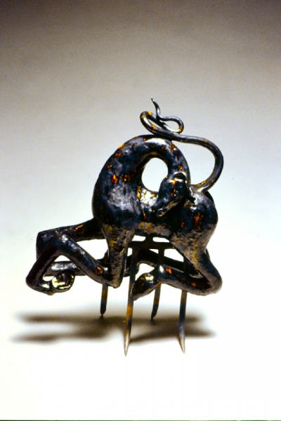 Tenderness, magnesium washed amber glazed earthenware and found altered object. 21x17x6""