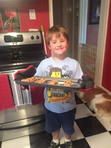 Landon loves to help cook and bake.