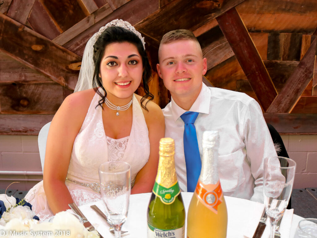 Bride and Groom Smiling Sweetheart Table Weborg 21 Centre Gering