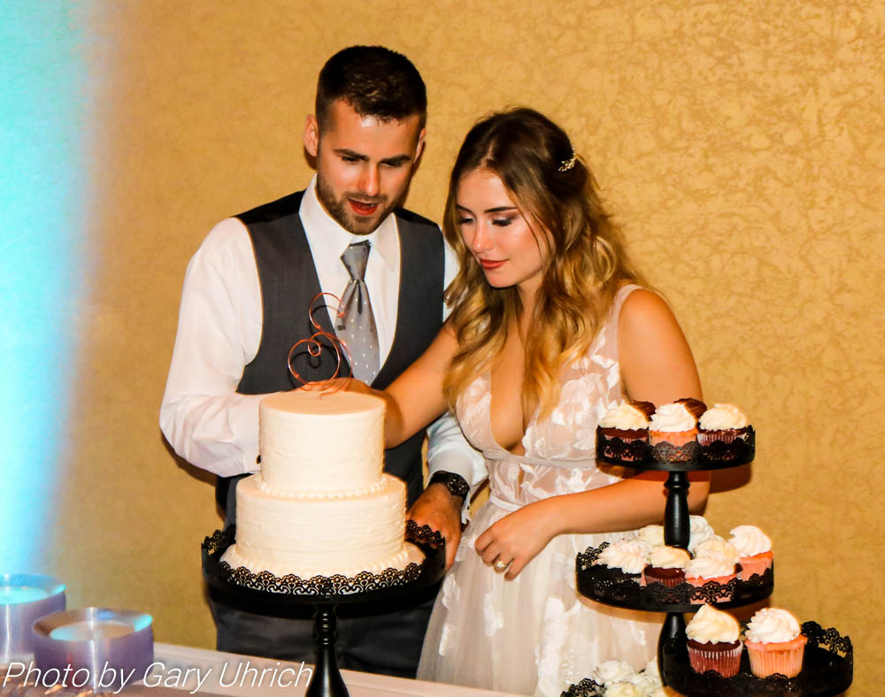 Bride and Groom cutting cake.