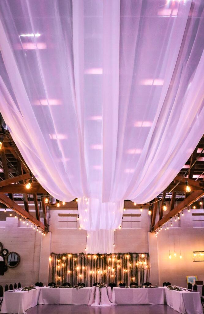 Wedding Draping Backdrop Market Lights Greenery Venue Gering Nebraska The DJ Music System Scottsbluff Nebraska