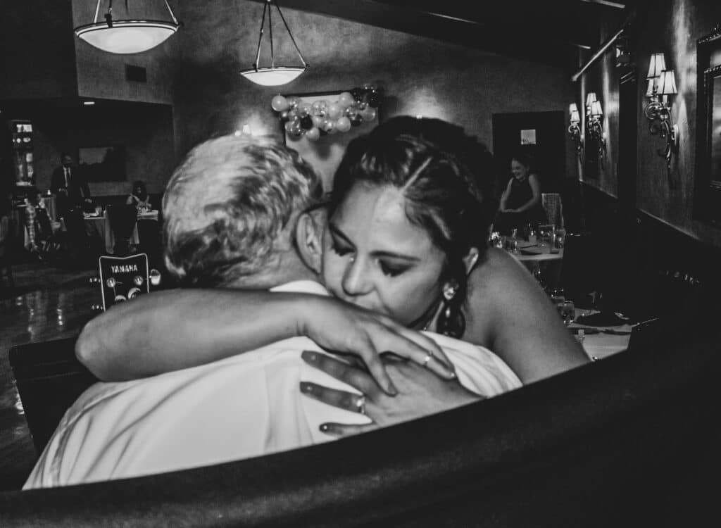 The moment after the first dance.  Audrey's dad singing meant so much to her.